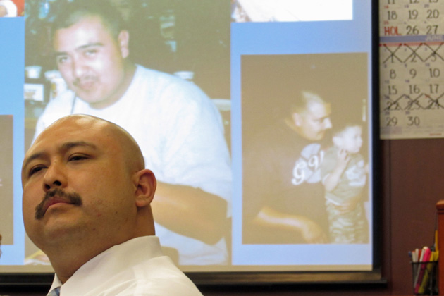 With pictures of murder victim Anthony Ibarra on the screen behind him, Ramon Maldonado listens as the victim's family speaks about the crime's impact Friday afternoon in Santa Barbara County Superior Court.