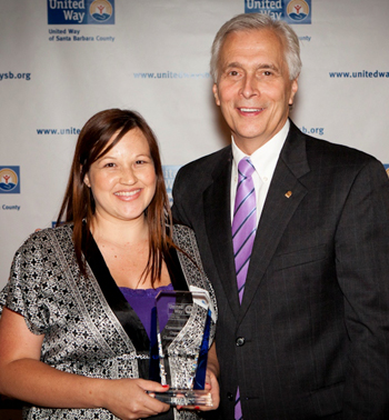Brianna Aguilar accepts the Community Impact Organization Champion of the Year award for Montecito Bank & Trust from Paul Didier, CEO and president of United Way of Santa Barbara County. (United Way of Santa Barbara County photo)