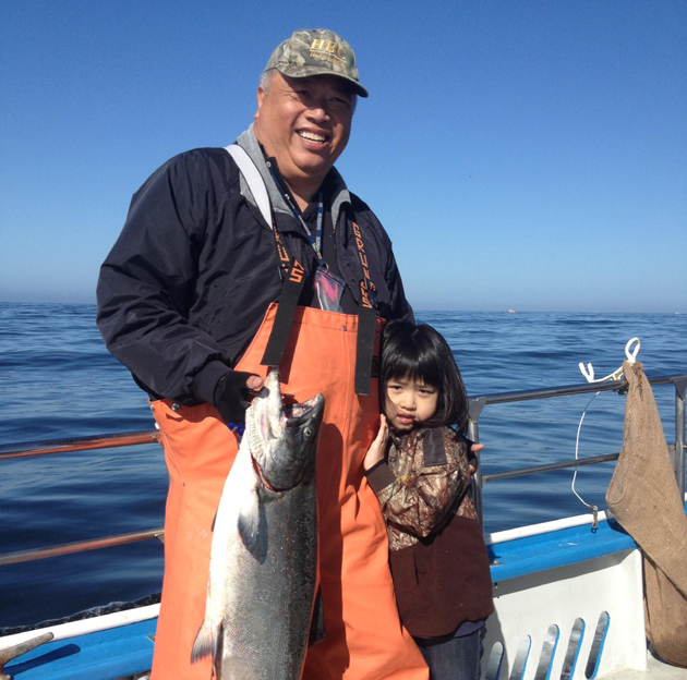 <p>Don Mah with daughter Tiffany on her first fishing trip.</p>