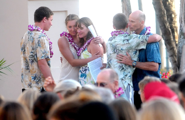 Jackson and Carly Wopat, left, greet their mother, Kathy, as son Eli embraces their father, Ron, during a May 24 gathering to honor the life of beloved daughter and sister Samantha Wopat, who died March 25 at Stanford Hospital from an undisclosed medical emergency.