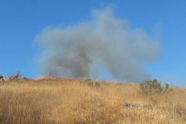 Smoke rises from a vegetation fire that broke out Tuesday afternoon in the hills behind the Glen Annie Golf Club in western Goleta. The blaze charred about half an acre.
