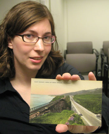 Lisa Koch, metadata librarian at UCSB's Davidson Library, holds a postcard from the Santa Barbara Historic Postcard Collection.