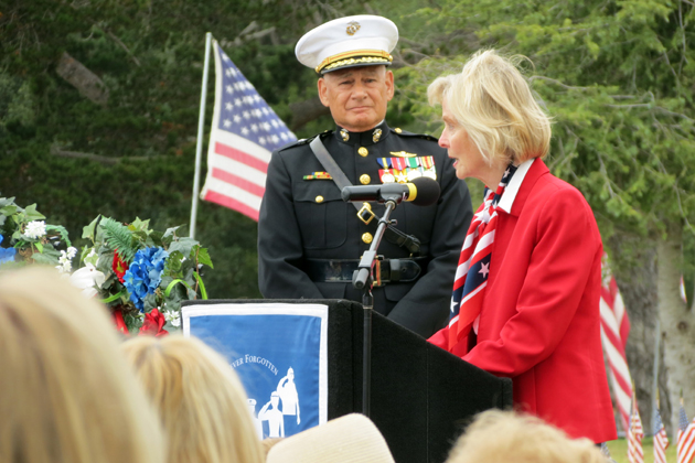 Retired U.S. Marine Corps Brigadier General Frederick Lopez reacts to words from Rep. Lois Capps, who commented on the size of the large crowd gathered Monday for the Memorial Day event at the Santa Barbara Cemetery.