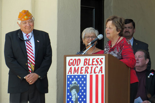 Alice Milligan, right, speaks during a ceremony Monday to celebrate the renovation of the Lompoc Veterans Memorial Building. She also announced that the kitchen will be named for Don and Adele Ramirez, left.