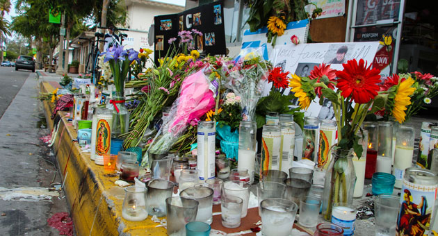<p>A growing memorial of flowers, candles and mementos sits in front of the IV Deli Mart, where one of six people killed by Elliot Rodger died. Some questions remain about the details of Friday night&#8217;s murderous rampage.</p>