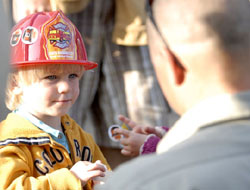 Corbett Bryant, 2, accepts a sticker Tuesday from Los Padres National Forest worker Mike Billgren