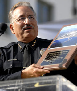 Santa Barbara Police Chief Cam Sanchez receives an award Tuesday for the police work involved with the Jesusita Fire