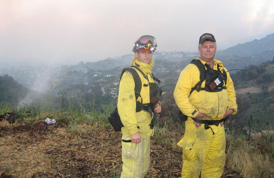 <p>Firefighters watch over Rattlesnake Canyon early on May 7 during the Jesusita Fire.</p>