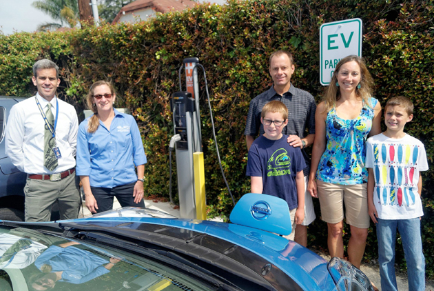 <p>From left, Peabody Charter School Principal Demian Barnett, Santa Barbara County Air Pollution Control District community programs supervisor Molly Pearson, and Peabody family John and Barbara Gilner and their sons, Luke and John, with their electric vehicle at Peabody&#8217;s new charging station.</p>