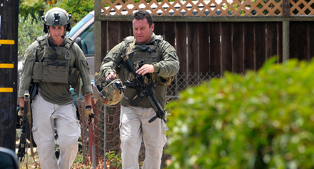 SWAT officers swarmed a residential neighborhood Thursday after a call came in reporting a man had killed his wife and child, but the incident was eventually deemed to be a hoax.