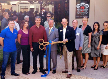 Members of the Goleta Valley Chamber of Commerce and other supporters celebrate the grand opening of Twenty Four 7 Moving Specialists Inc. at 26 Castilian Drive in Goleta.
