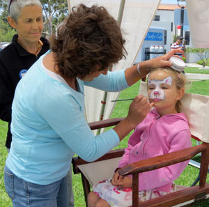 Face-painting was among the many free activities available to cancer survivors and their families at Viva la Vida. (Gina Potthoff / Noozhawk photo)