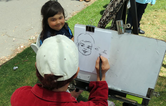 Free caricatures were available to cancer survivors and their families at Viva la Vida. (Gina Potthoff / Noozhawk photo)
