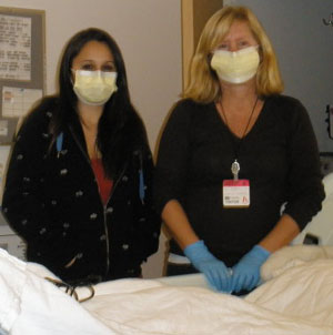 Girlfriend Laura Beavers, left, and mom Debbie Williams visit Bryson in the hospital