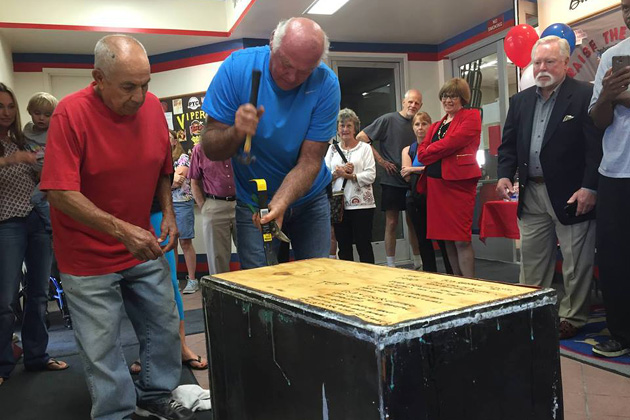 Present and past members gather Tuesday to open a 25-year-old time capsule.