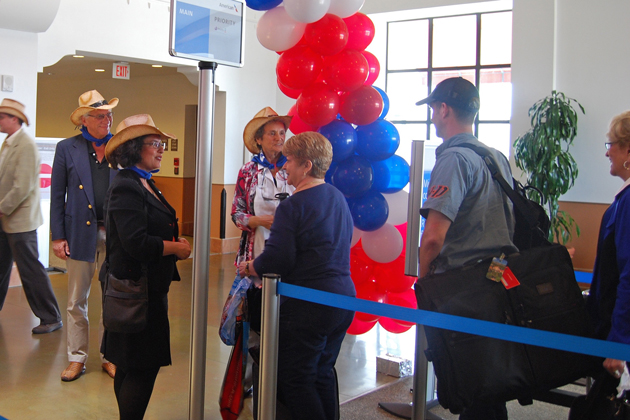 Santa Barbara Mayor Helene Schneider welcomes travelers arriving on the first direct flight from Dallas, Texas.