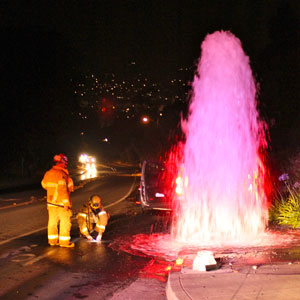 A fire hydrant was sheared off late Tuesday night in a multi-vehicle accident on Carrillo Hill in Santa Barbara. (Urban Hikers photo)