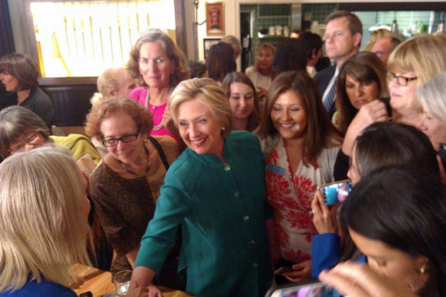 Democratic presidential candidate Hillary Clinton visits with supporters during a quick visit to Jill's Place restaurant in Santa Barbara on Saturday afternoon.