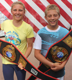 Local surfers Lakey Peterson and Parker Coffin proudly show off their titles
