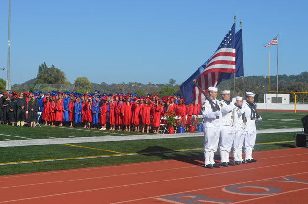 A military color guard carries the American Flag at San Marcos High School.