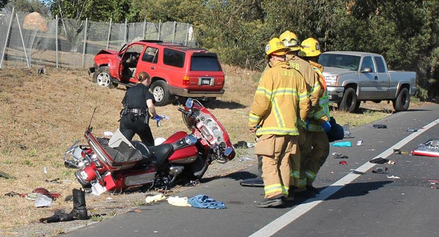 Santa Barbara police and firefighters collect evidence and investigate the scene of a May 29 collision involving the red SUV in the background and a Canadian couple riding their motorcycle on Old Coast Highway. The couple, Ellen and Jim Atwood of Orangeville, Ontario, remain hospitalized with severe injuries, including the loss of their left legs. The SUV driver, Martin Maguire of Montecito, has pleaded not guilty to a felony DUI charge in the wreck and has been released on bail. (Urban Hikers photo)