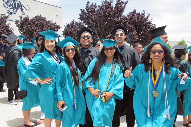 Members of the Pioneer Valley High School class of 2016 pose for a picture while waiting in line for the start of the ceremony Thursday.