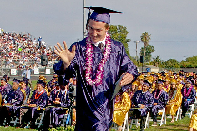 With his diploma in hand, a member of Dos Pueblos High School's Class of 2015 crosses the stage during Wednesday's graduation ceremony.