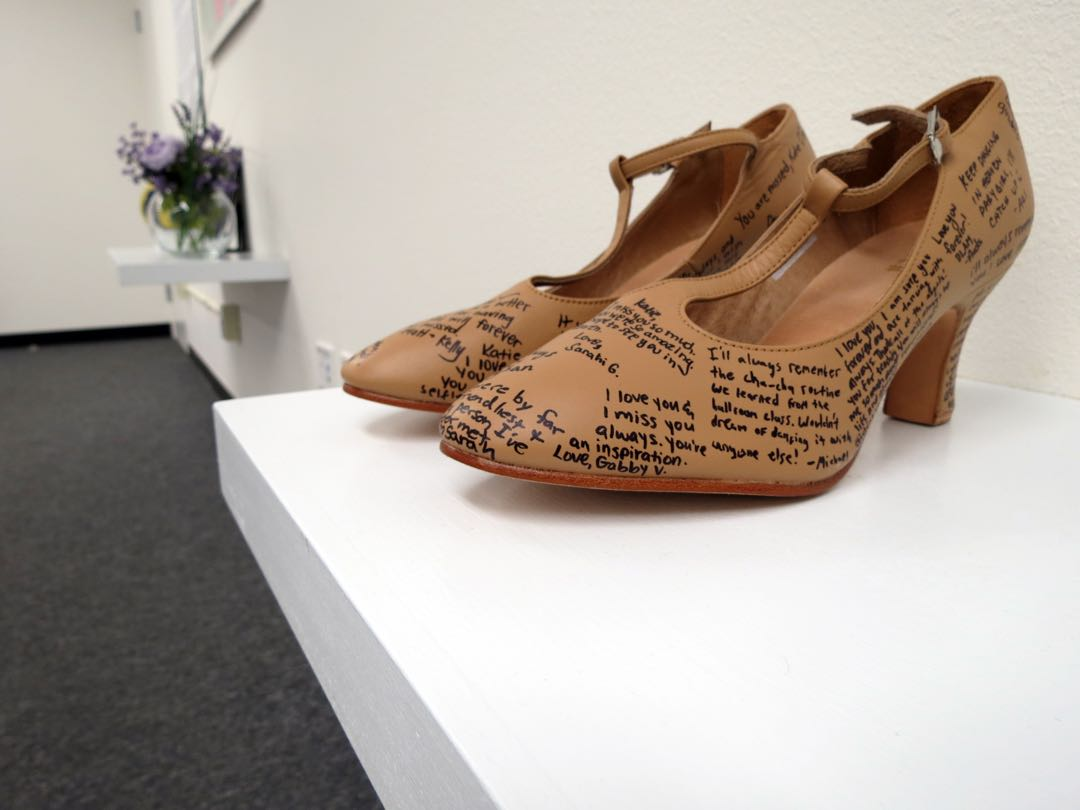 "Katie Cooper, one of six UC Santa Barbara students killed during the 2014 Isla Vista massacre, was a ballroom dancing enthusiast and instructor. Her friends wrote messages and signed a pair of ballroom shoes to display in the new ""We Remember Them"" exhibit, which is open through June 20 at UCSB."