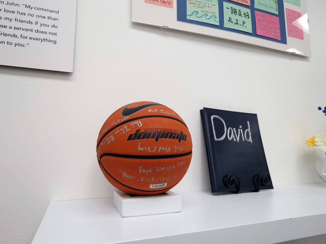 "Student and UCSB library curators got family and friends of each victim to sign and write messages on a sports object. Weihan ""David"" Wang's family described how he loved basketball."