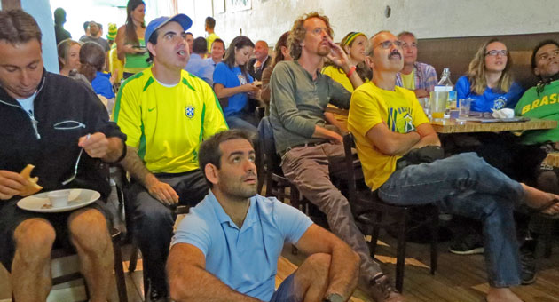 <p>Soccer fans at the Brasil Arts Café keep a close watch on a World Cup match between Brazil and Croatia this week. The restaurant is one of several local businesses catering to World Cup fans.</p>