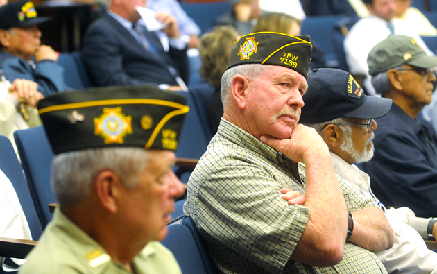 Veterans Alvin Salgee and John Feazelle listen Wednesday as the Santa Barbara County Board of Supervisors discusses potential budget cuts, including a Veteran Services officer position.