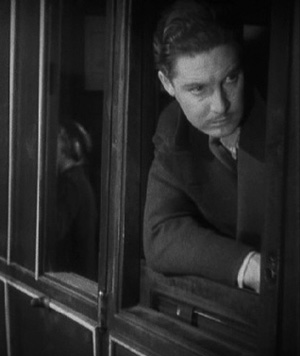 Richard Hannay (Robert Donat) travels apprehensively to Scotland in Alfred Hitchcock's The 39 Steps.