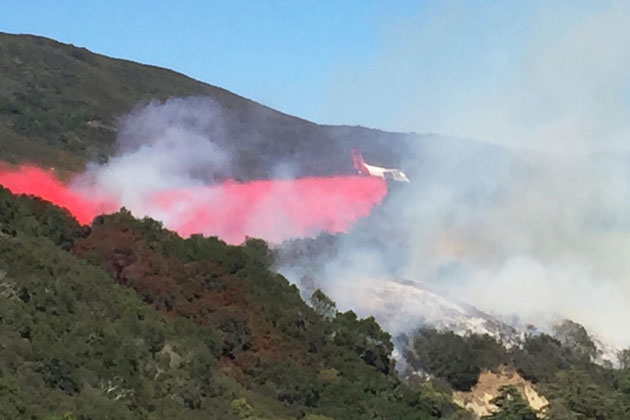 An air tanker makes a drop of fire retardant on a vegetation fire burning Wednesday in Refugio Canyon near Gaviota.
