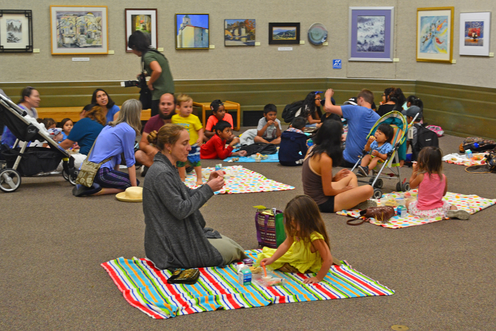 Families gather at the Santa Barbara Central Library for a Picnic in the Park event Thursday. The Foodbank of Santa Barbara County is helping provide free lunchtime meals to children there every Monday through Friday until Aug. 22.
