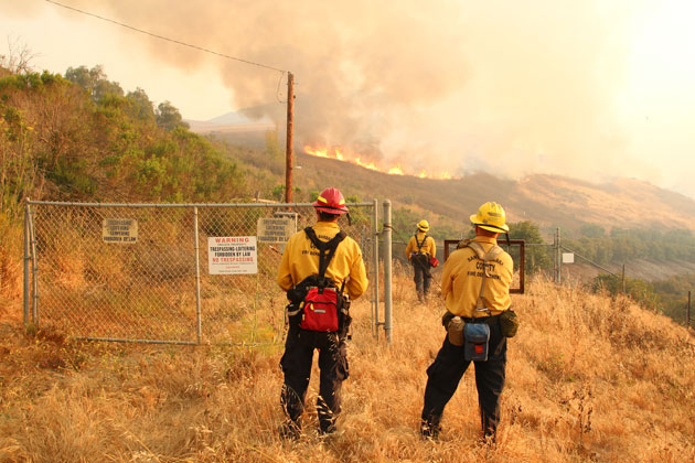Firefighters keep an eye on the fast-growing Sherpa Fire that started Wednesday afternoon near Refugio Road on the Gaviota coast.