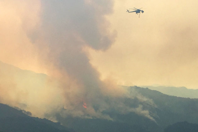 The Sherpa Fire grew to more than 1,200 acres overnight and a full air attack continued Thursday.