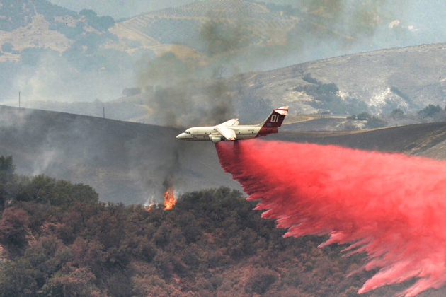 An air tanker drops flame retardant on the east flank of the Sherpa Fire Thursday afternoon.
