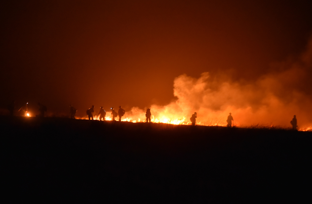 Fire crews work to control the Sherpa Fire Thursday night.