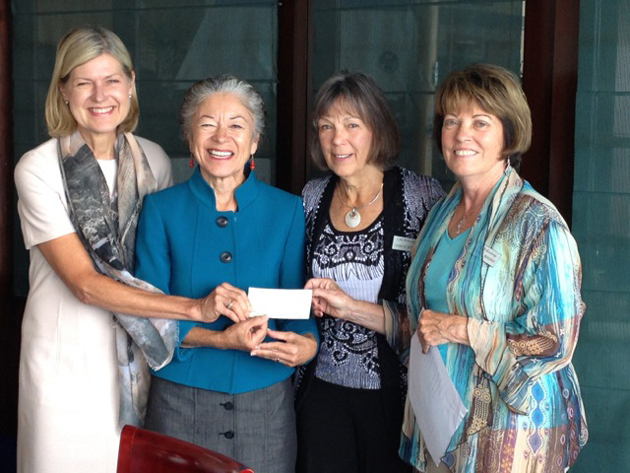 <p>CALM board president Nancy Bollay, left, CALM Executive Director Cecilia Rodriguez, CALM Auxiliary president Marcia Wolfe and CALM Auxiliary treasurer Martha Rodgers celebrate the auxiliary's fundraising efforts during the past year, totaling more than $150,000, with a check presentation last week.</p>