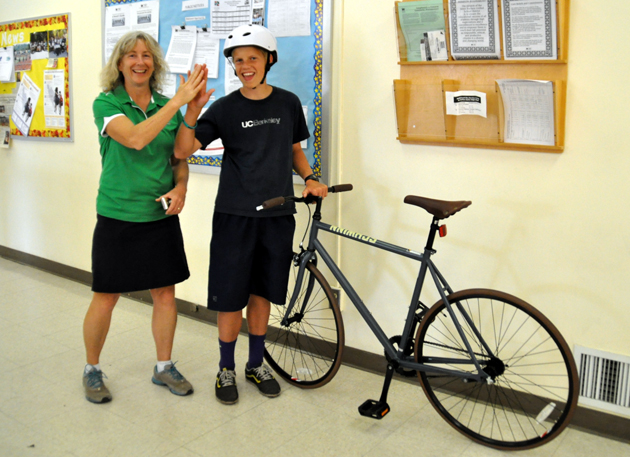 <p>La Colina Junior High seventh-grader Lucas Eilbacher gets a high-five as he accepts the bike he won through COAST&#8217;s National Bike to School Day.</p>