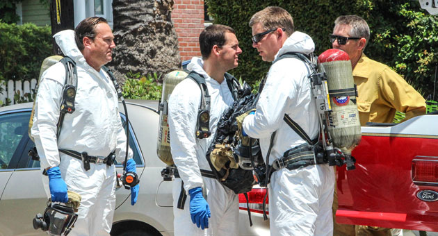 The Santa Barbara Fire Department hazmat team suits up to carry out a grisly mission. (Zack Warburg photo)