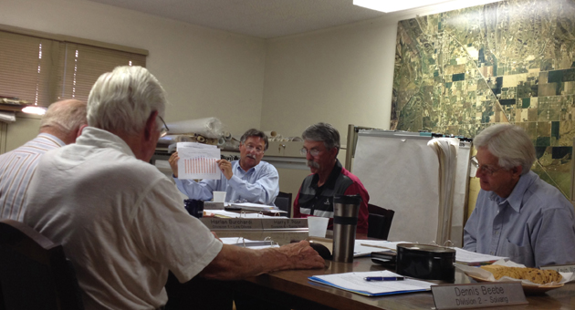 <p>General Manager Chris Dahlstrom holds up a chart showing water use and supply during Tuesday night&#8217;s meeting of the Santa Ynez River Water Conservation District board.</p>