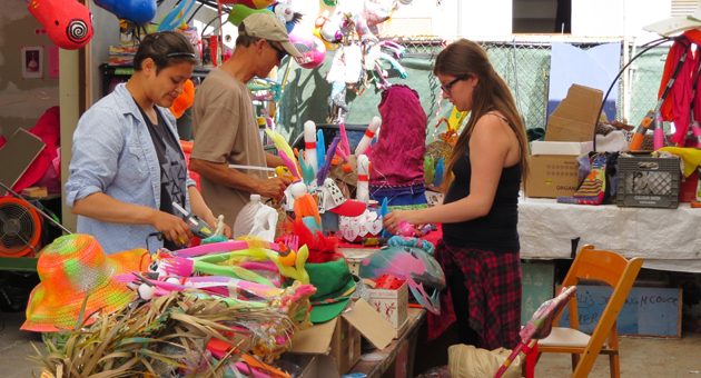 <p>Locals worked on floats to ride during Saturday&#8217;s Summer Solstice parade. The Community Arts Workshop on Garden Street was home to hundreds of floats designed around the 2014 &#8220;Games&#8221; theme.</p>
