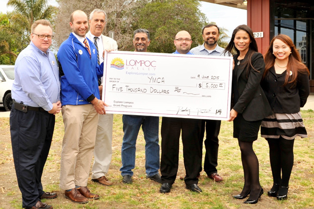 "Representatives of Explore Lompoc present a check for $5,000 to the Lompoc Family YMCA to sponsor the 16th annual ""Kids for Character"" Golf Tournament slated for July 17."