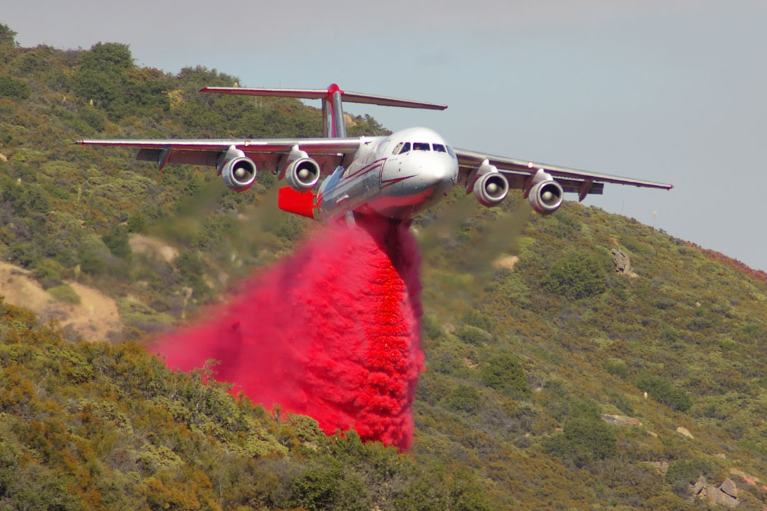 A tanker makes a retardant drop during the Sherpa Fire.