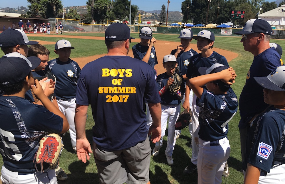 Manager DJ Gesswein talks to his Dos Pueblos Little League 12-Under All-Star team after its win against Montalvo on Saturday.
