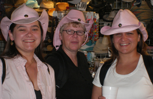 A mom and her daughters show off their matching hats at the Mid-State Fair in Paso Robles.