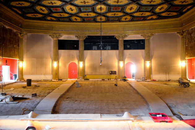 <p>With the seats removed for ceiling and interior work, the Lobero Theatre is a cavernous room in a view from the stage.</p>