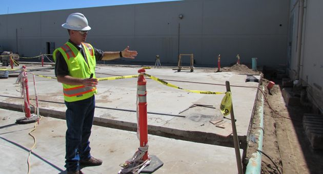 <p>Santa Maria police Cpl. Bob Prescott, providing a tour of the department's new headquarters under renovation at 1111 W. Betteravia Road, talks about the sally port area where officers will be able to securely bring people they arrest.</p>