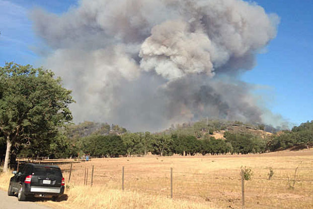 Smoke billows up Saturday from a vegetation fire that had charred more than 1,000 acres near Santa Margarita in northern San Luis Obispo County. Several houses were reported burned, and hundreds of residents were encouraged to evacuate.
